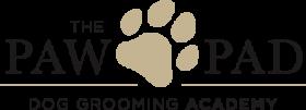 paw pad dog grooming academy logo